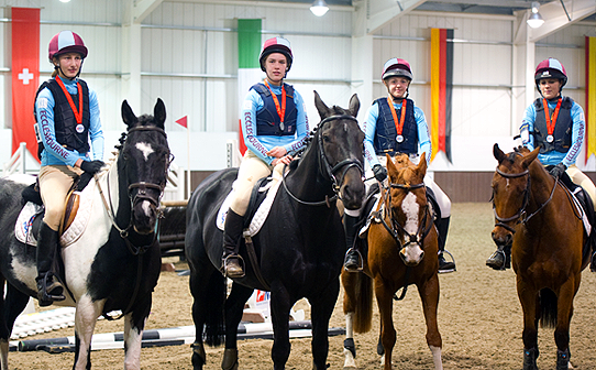 Ecclesbourne Equestrian team at the NSEA National Championships in CustomXC colours