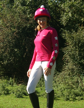 Striking fuchsia cross country colours with hat cover and pom pom