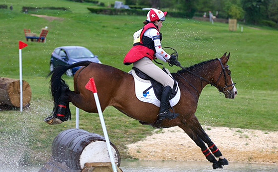 Lara Sharrock of Oxfordshire wearing XC colours in white, red and orange at Broadway BE Novice
