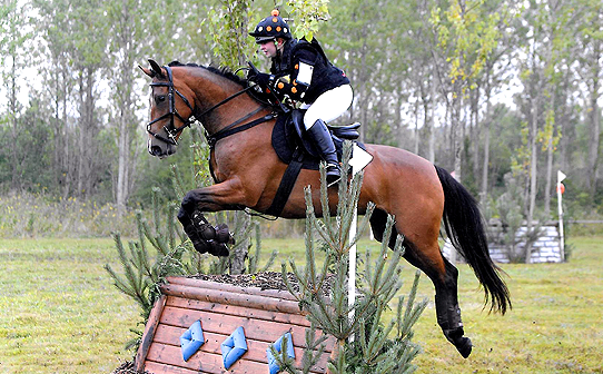 Emma Fiely in black, orange and white CustomXC cross country colours