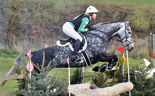 Luci and Tilly jumping fence in emerald, yellow and white XC set