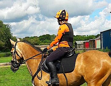Lisa wearing Orange and Black bespoke XC Colours