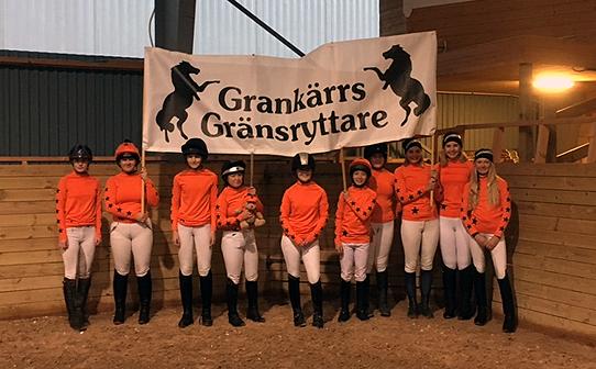 Eventing team wearing orange team colours