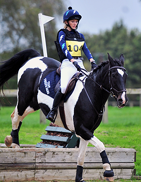 Navy, white and carpi XC Colours: jumping a jump and hug for the horse