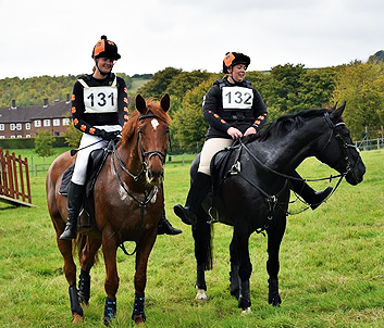 Right: Black and orange team colours, Left: Leanne wearing capri and white XC
