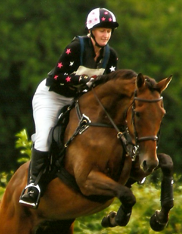 Personalised black, pink and white polo with matching hat silk plus new horse equals winning combination!