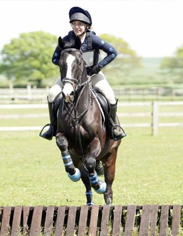Laurie Moore cross country jumping (ODE) in navy colours with glitter stars