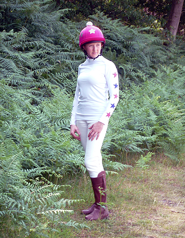 White Baselayer from CustomXC. Background is a local cross country jump