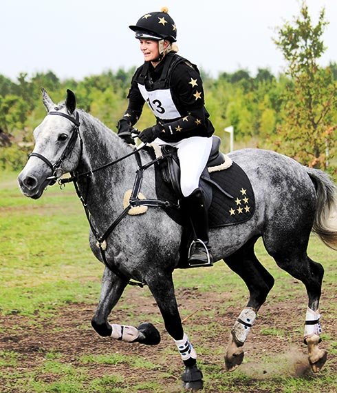 Matching set of XC Colours in black and gold including baselayer, hat cover and saddle cloth